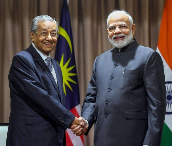 Prime Minister Narendra Modi shakes hands with his Malaysian counterpart Mahathir Mohamad, on the sidelines of 5th Eastern Economic Forum, at Vladivostok, in Russia, on September 5, 2019. PIB/PTI