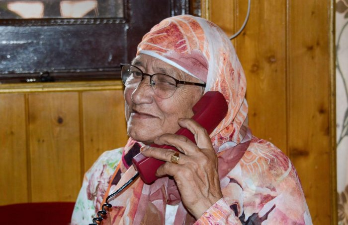 An elderly resident talks on phone after authorities in Kashmir restored 19 more telephone exchanges, a month after telephone services were snapped following abrogation of provisions of Article 370, in Srinagar, Thursday, Sept 5, 2019. (PTI Photo)