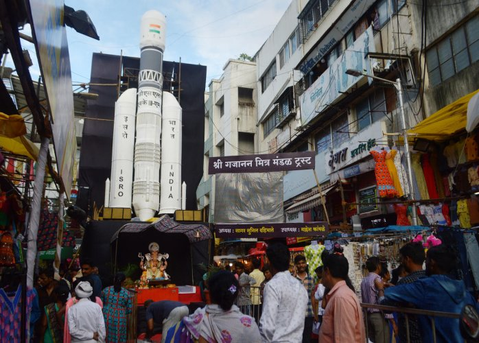 Devotees at a Ganesh 'Mandap' created on the theme of Chandrayaan-2 launch during Ganpati festival in Pune, Thursday, Sept 5, 2019. (PTI Photo)