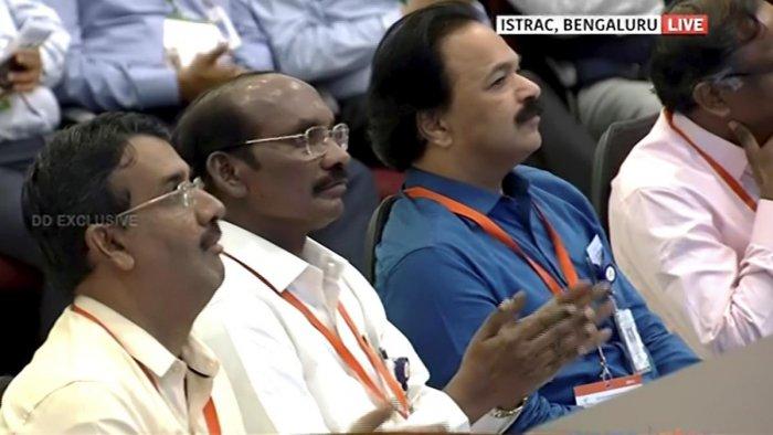 ISRO Chairman Kailasavadivoo Sivan (C) watches the live telecast of soft landing of Vikram module of Chandrayaan 2 on lunar surface. PTI Photo