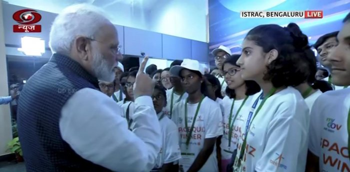 Prime Minister Narendra Modi interacts with students after connection with the Vikram lander was lost during soft landing of Chandrayaan 2 on lunar surface, in Bengaluru. (PTI Photo)