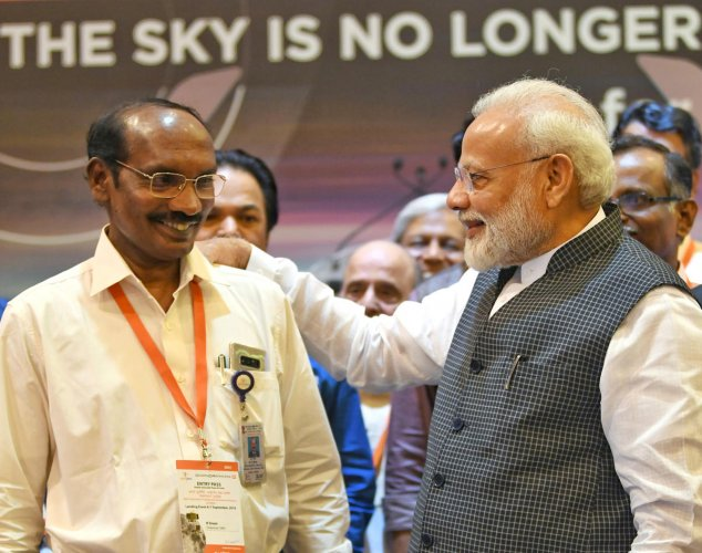 Prime Minister Narendra Modi talks to ISRO chief K Sivan in Bengaluru. (Reuters Photo)