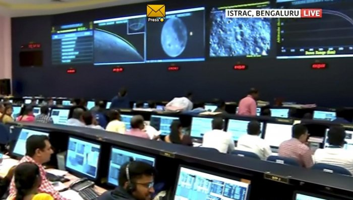 Officials watch live telecast of Chandrayaan 2 at ISRO Telemetry Tracking and Command Network (ISTRAC). (PTI Photo)