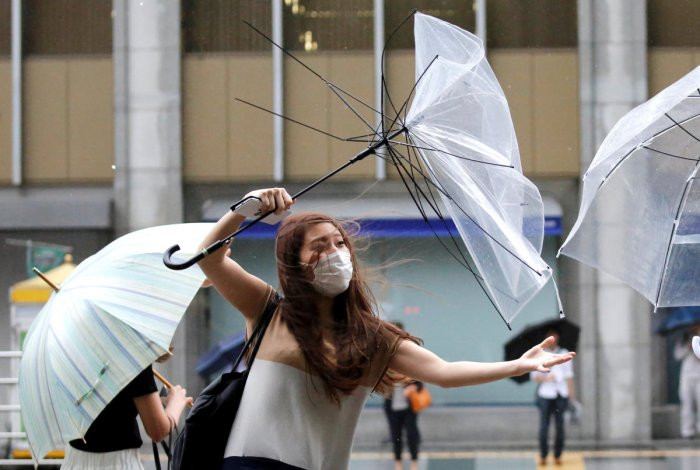 A woman using umbrella struggles against the strong wind in Japan's mainland in Tokyo. (Representative Image) (Photo by Reuters)