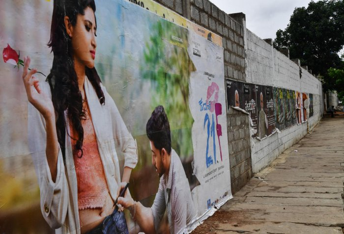 BBMP banned hoardings and posters a year ago, but they are still allowed inside movie halls.