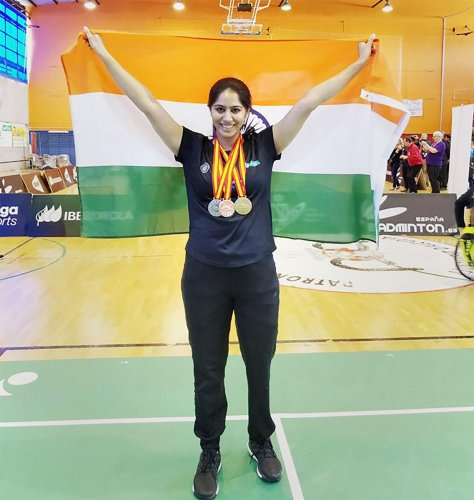 Para-badminton player Manasi Joshi poses for pictures after winning her first World Championships in the women's singles SL3 finals at Basel 2019 Championships. PTI Photo