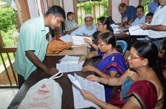 People check their names on the National Register of Citizens (NRC) final list at a National Register of Citizens office at Guwahati, Assam on Saturday. (PTI Photo)