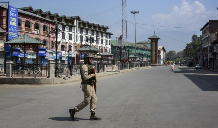 Commercial hub of Lal Chowk and adjoining areas were completely sealed off by placing concertina wires at all entry points where a large number of security force personnel were deployed, officials said. (PTI Photo)