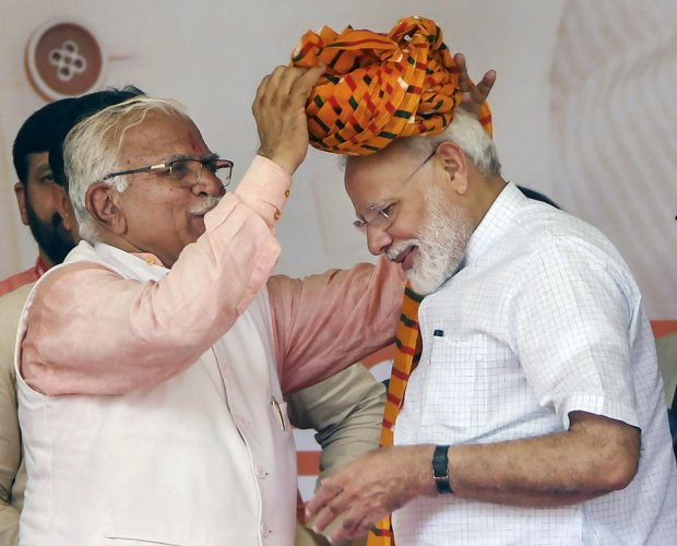 Rohtak: Prime Minister Narendra Modi is presented a turban by Haryana Chief Minister Manohar Lal Khattar during a public rally, in Rohtak, Sunday, Sept 8, 2019. (PTI Photo)