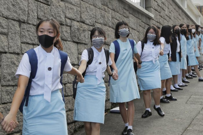 Students form human chain outside the Maryknoll Convent School in Hong Kong (PTI Photo)