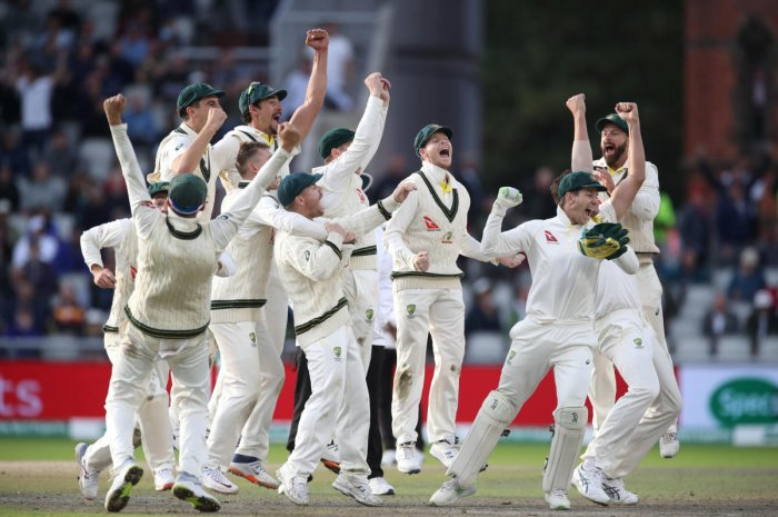 Australia celebrate the wicket of England's Craig Overton to win the match and retain the Ashes. Reuters