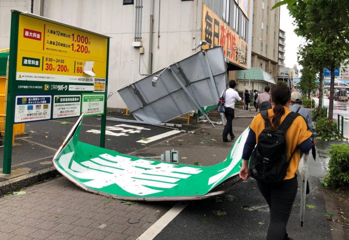 Collapsed steel advertising boards caused by Typhoon Faxai are seen at Edgawa ward in Tokyo, Japan (Reuters Photo)