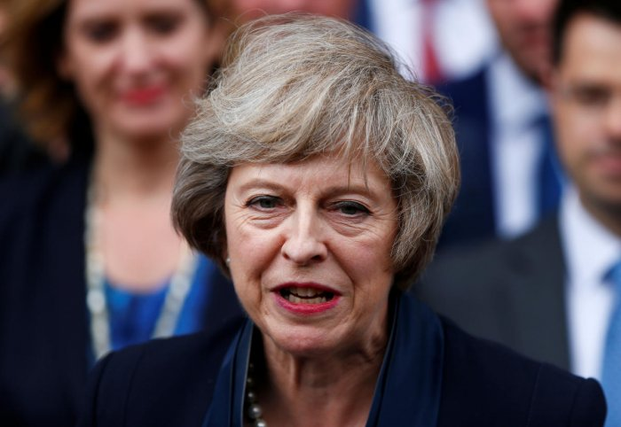 May previously mocked her predecessor David Cameron's decision to knight his communications director Craig Oliver. Reuters photo