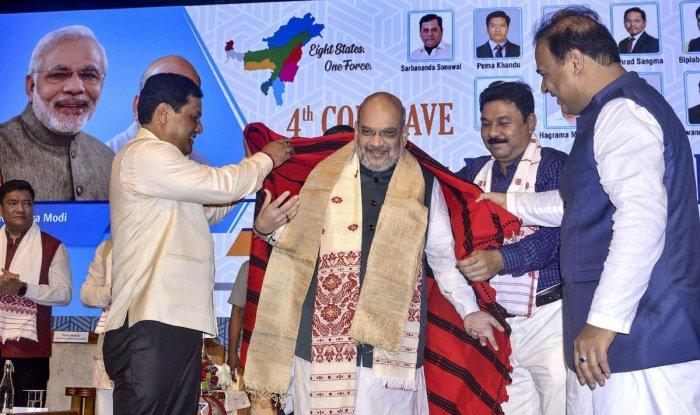 Guwahati: Union Home Minister Amit Shah being feliciated by Assam Chief Minister Sarbananda Sonowal during the 4th Conclave of the North East Democratic Alliance (NEDA), in Guwahati, Monday, Sept 9, 2019. (PTI Photo) (PTI9_9_2019_000075B)