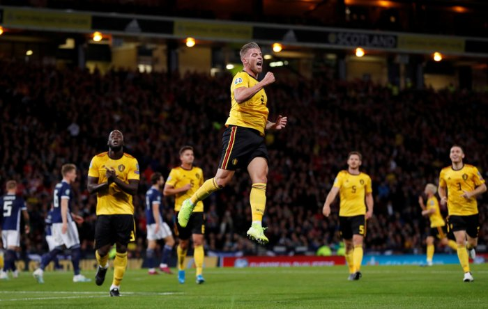 Belgium's Toby Alderweireld celebrates scoring their third goal with Romelu Lukaku. Reuters Photo