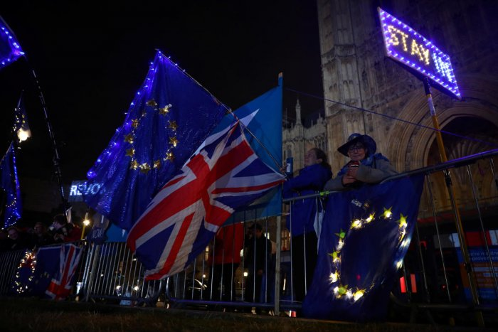 Anti-Brexit demonstrators stand outside the Houses of Parliament in London, Britain. (Reuters Photo)