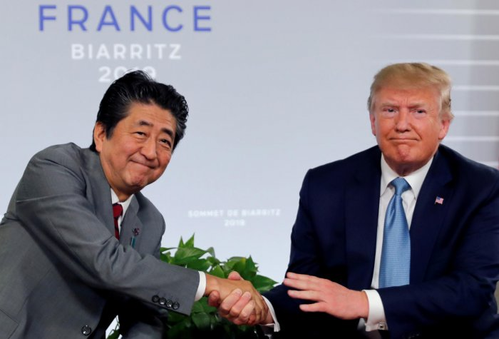 US President Donald Trump and Japan's Prime Minister Shinzo Abe shake hands at a bilateral meeting during the G7 summit in Biarritz, France. Reuters File Photo