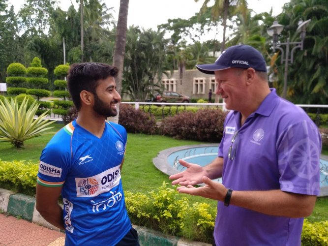 Indian men's hockey coach Graham Reid (right) interacts with captain Manpreet Singh at the SAI, Southern Centre, in Bengaluru on Tuesday. DH PHOTO/VIVEK MV