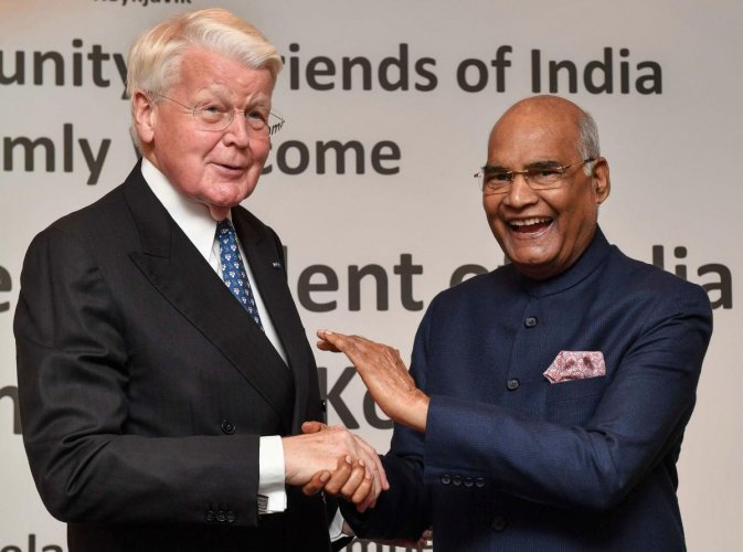 President Ram Nath Kovind, shakes hands with former Icelandic president Ólafur Ragnar Grímsson while attending the Indian community reception at a hotel in Reykjavik, Iceland. PTI Photo