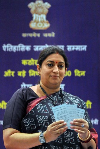 Union Minister for Women and Child Development, and Textiles Smriti Irani launches booklets at a press conference on completion of 100 days by the NDA government 2, at New Town on the outskirts of Kolkata. PTI