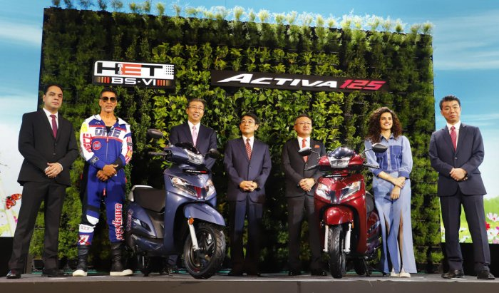 Bollywood actors Akshay Kumar and Taapsee Pannu with Honda Motor Managing Officer, Motorcycle Operations, Noriaki Abe (C) and other company representatives of Honda Motorcycle & Scooter India (HMSI) at the unveiling of Honda BS6 Activa 125cc, in Gurugram in June, 2019. (Photo/PTI)