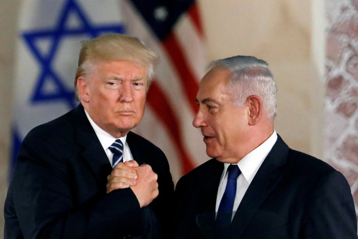 FILE PHOTO: U.S. President Donald Trump and Israeli Prime Minister Benjamin Netanyahu shake hands after Trump's address at the Israel Museum in Jerusalem May 23, 2017. REUTERS/Ronen Zvulun/File Photo