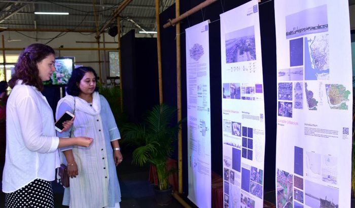 A student of Welsh School of Architecture (WSA) of Cardiff University explains the exhibition of their finding to Mangaluru Smart City Limited In-charge MD Snehal R,at Mini Town Hall in Mangaluru on Tuesday.