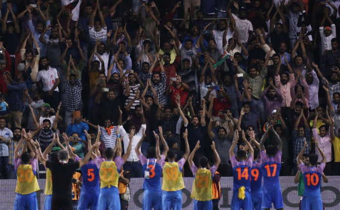 India celebrate with fans after the match. (REUTERS/Ibraheem Al Omari)