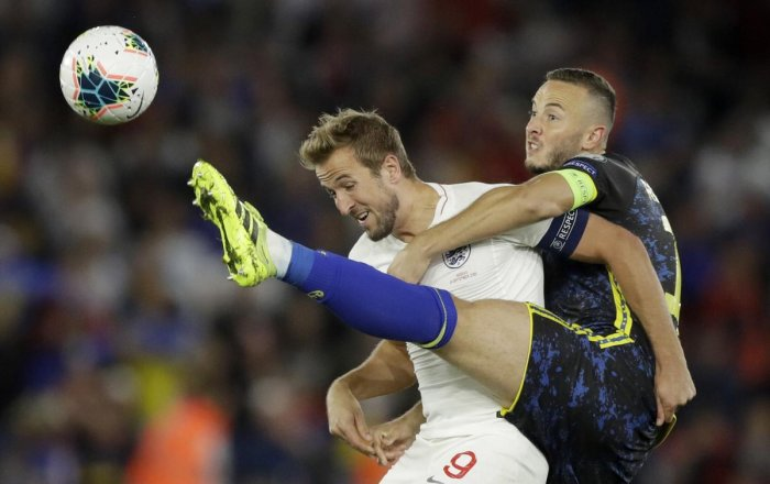 England's Harry Kane, left, and Kosovo's Amir Rrahmani challenge for the ball during the Euro 2020 group A qualifying match. PTI/AP Photo