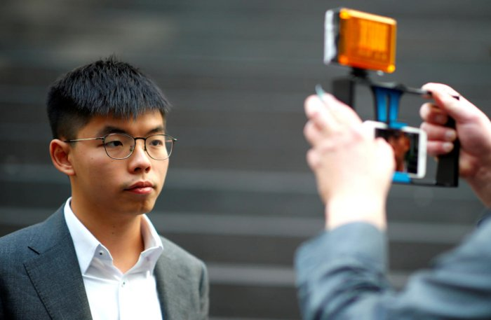 Hong Kong's pro-democracy activist Joshua Wong poses after a news conference in Berlin. Reuters