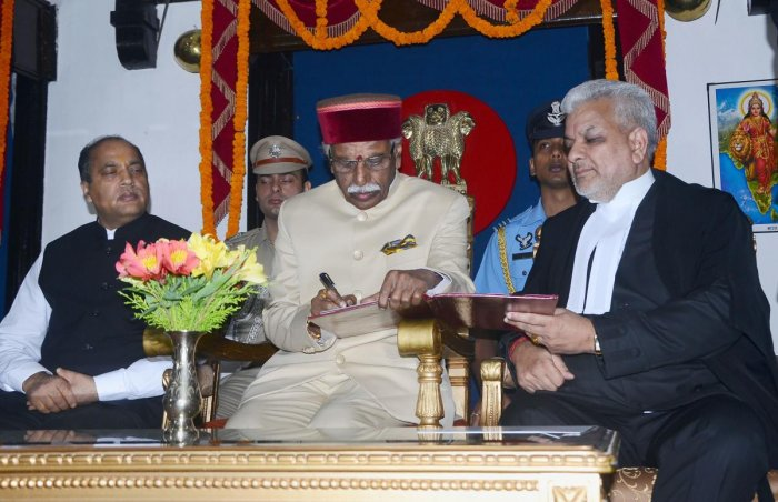 Himachal Pradesh High Court Justice Dharam Chand Chaudhary administers the oath of office to Himachal Pradesh Governor Bandaru Dattatreya. PTI Photo
