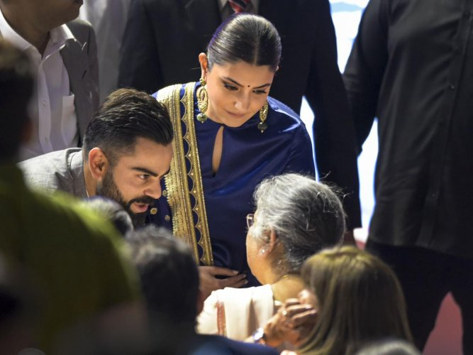 Virat Kohli and his wife Anushka Sharma interact with the family members of the late politician-cum-sports-administrator Arun Jaitley, at an event to rename Feroz Shah Kotla Stadium as 'Arun Jaitley Stadium', during DDCA's Annual Awards function, in New Delhi. PTI