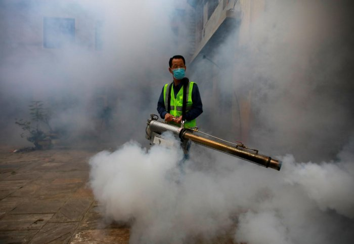 A worker fumigates a resident area to prevent the spread of the dengue fever and other mosquito-borne diseases in Kathmandu, Nepal. (Photo by Reuters)