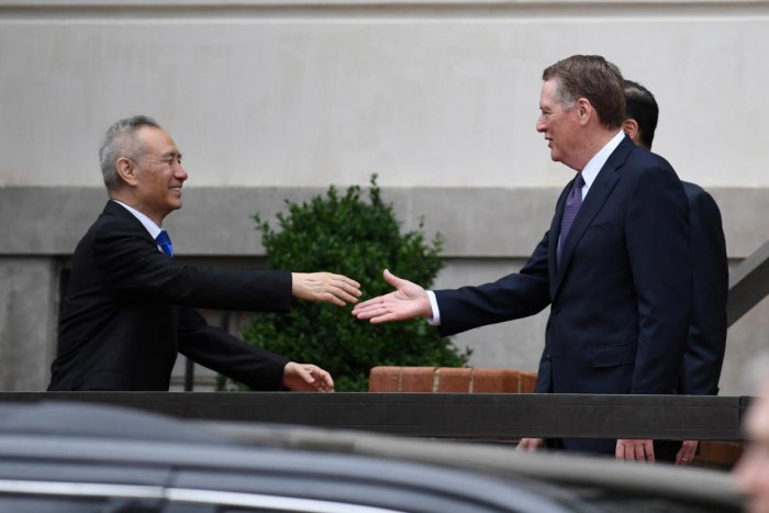 Chinese Vice Premier Liu He shakes hands with U.S. Trade Representative Robert Lighthizer outside the office of the U.S. Trade Representative. (Reuters Photo)