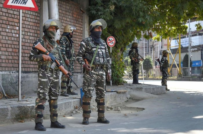 Srinagar: Security personnel stand guard during curfew like restrictions in Srinagar. (PTI Photo)