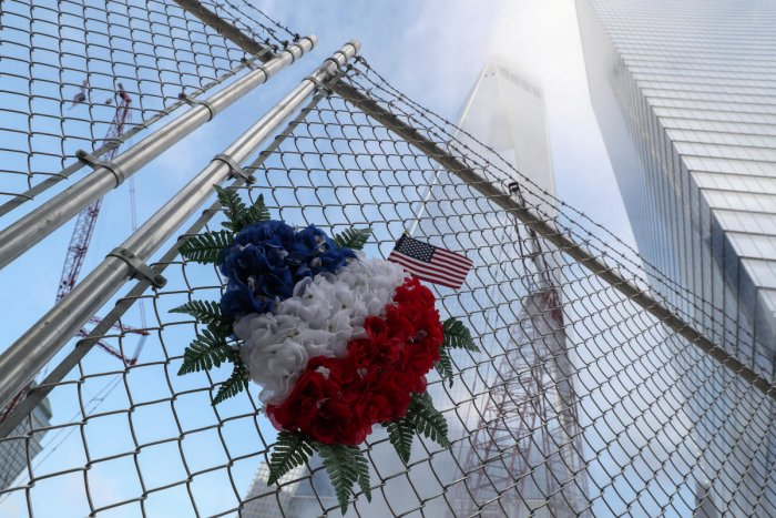 Flowers are seen left on a fence near the One World Trade Center tower on the 18th anniversary of the September 11, 2001 attacks in lower Manhattan in New York, U.S., September 11, 2019. (Photo by Reuters)
