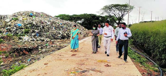 Dakshina Kannada Deputy Commissioner Sindhu Rupesh and other officialsvisited the garbage slide-affected areas of Pacchanady on Wednesday.