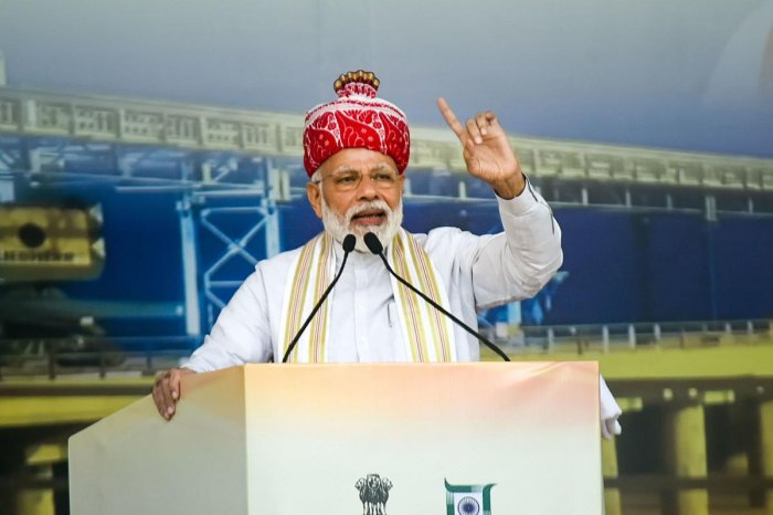 Prime Minister Narendra Modi addresses during the inaugural function of newly constructed Jharkhand Assembly, Sahebgunj Multiport and launch of Kisan Maan Dhan Yojana at Prabhat Tara Ground, in Ranchi district of Jharkhand, Thursday, Sept. 12, 2019. (PTI Photo)