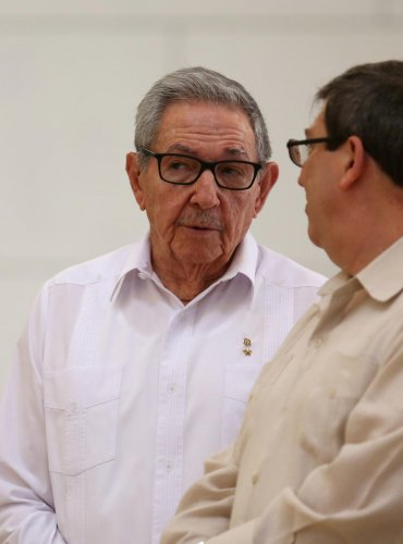 Cuba's First Secretary of the Communist Party and former President Raul Castro (L) talks with Cuba's Foreign Minister Bruno Rodriguez during an event with Russian Foreign Minister Sergei Lavrov (not pictured). (Photo by Reuters)