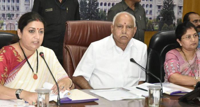 Union Minister for Women and Child Development and Textiles Smriti Irani, Chief Minister B S Yediyurappa and Minister of Women, Child Development and Empowerment of Differently Abled, Senior Citizens Shashikala Jolle during a meeting at the chief minister's home office Krishna in Bengaluru on Friday. DH Photo