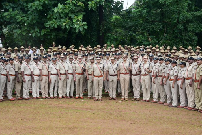 Commissioner of Police Dr P S Harsha along with police personnel and officers took part in the police service parade at CAR Ground in Mangaluru on Friday. DH Photo