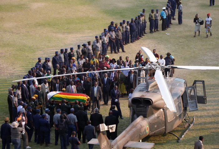 The casket carrying the body of former Zimbabwean President Robert Mugabe is carried to the military chopper after lying in state at the Rufaro stadium, in Mbare, Harare, Zimbabwe. (Reuters photo)