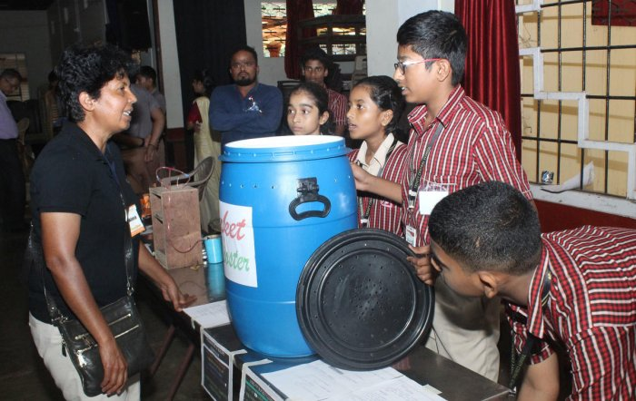 Students explain the working of a bucket compost to scientist Poornima Kamath at the 'Brain Quest' science festival organised at MGM College, Udupi, on Saturday.