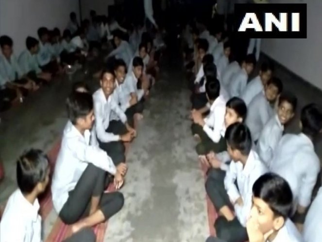 The students got stuck inside the school campus after the roads were blocked due to heavy discharge of water from Rana Pratap Dam. Photo/ANI