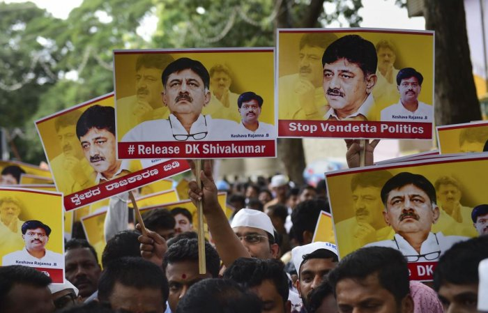 Vokkaliga community members hold posters during a protest against the arrest of Congress leader DK Shivakumar in a money laundering case in Bengaluru. PTI Photo