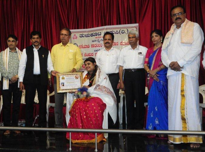 The 'S U Paniyadi Tulu Kadambari Award' was given to Akshatha Perla for the novel 'Bolli' at MGM College, Udupi, on Sunday.
