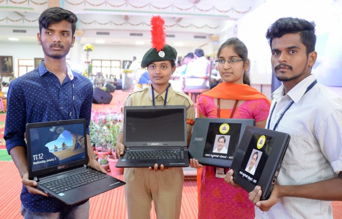 The students who received free laptops in 2016-17. DH File Photo