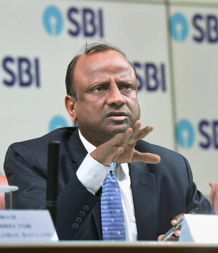 SBI chairperson Rajnish Kumar during the announcement of Q4 results, in Mumbai, on Tuesday. PTI