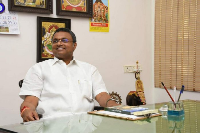 Sivaganga MP and former finance minister P Chidambaram's son - Karti Chidambaram - in his office. (DH Photo)
