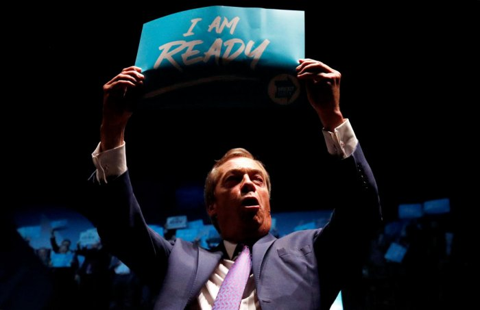 Brexit Party leader Nigel Farage holds a sign during a party event in Southport, Britain, September 13, 2019. (Photo by Reuters)